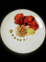 Serving fish Tikka with cilantro mint chutney, lemon wedges and sprouts salad for fish tikka recipe