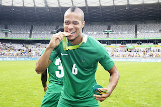 Troost-Ekong posing with his bronze medal
