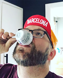Steve Agocs, the KC Coffee Geek sipping an espresso wearing a Barcelona hat