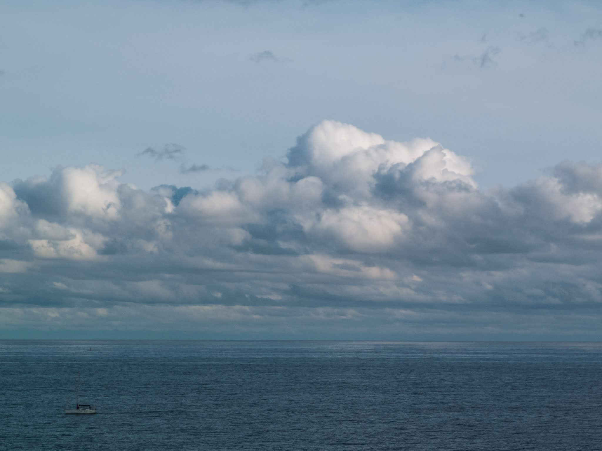 Cloudy skies and the Balearic Sea from the port of Barcelona.