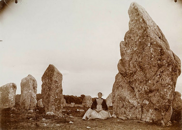 Woman at standing stones - menhirs - at Kermario alignments in Carnac, Britanny, France, photographer unknown, c. 1880