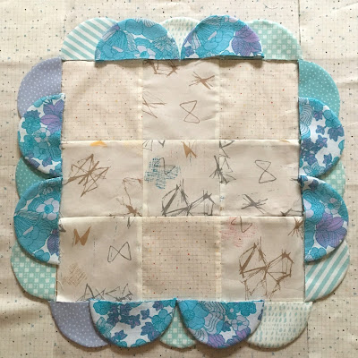 patchwork squares with 3D fabric scallops border
