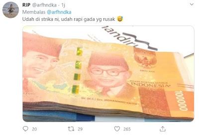 Uang telah disetrika dan rapi kembali