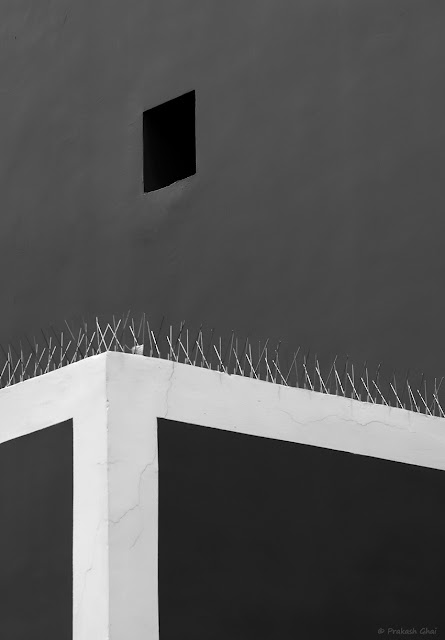 A Black and White Minimalist Photograph of White Paint Lines and a Black Square at Jawahar Kala Kendra, Jaipur.