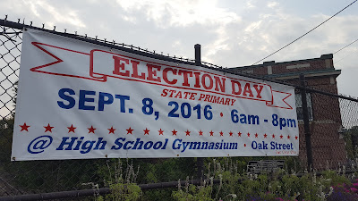 sign announces the state primary election on the railroad bridge downtown Franklin