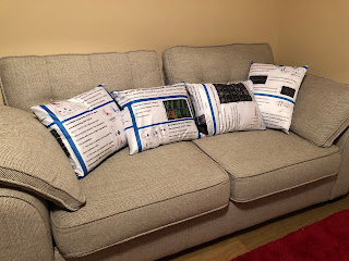 Couch with four cushions made from fabric conference poster