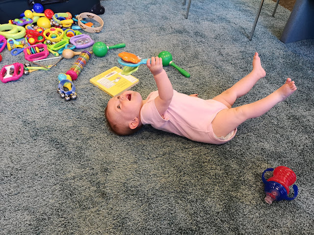 Gift Guide For One Year Olds Baby Playing With Musical Instruments Carpet Time