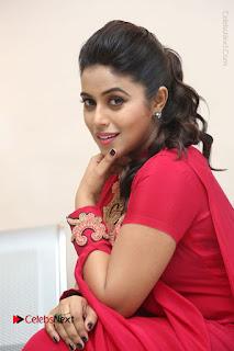 Actress Poorna Latest Stills in Red Dress at Rakshasi First Look Launch  0261.JPG