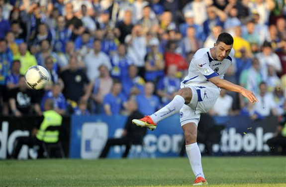 Bosnia-Herzegovina player Haris Medunjanin scores his side's third goal against Latvia
