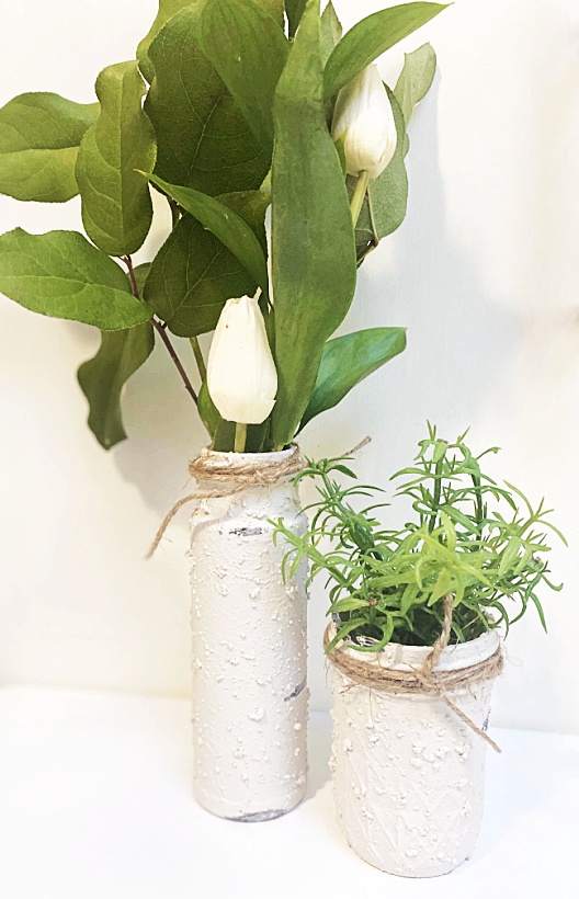 vase and mason jar filled with plants