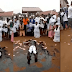 Ghanaian Pastor rolls in engine oil, while members spray money on him during church crusade (Video)