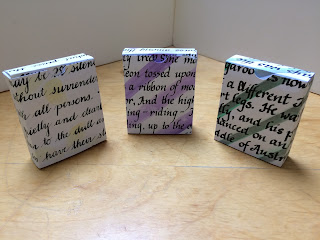 Tuckboxes for flashcards decorated with calligraphy.