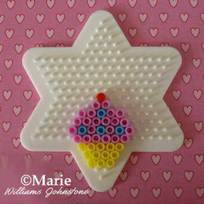 Star shaped pegboard with cake beaded design