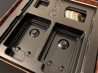 The box insert for Caper, showing the moulded card wells that look like safes.