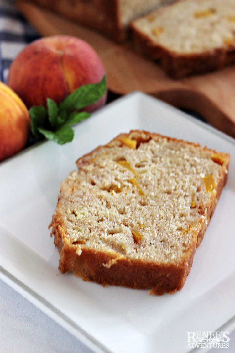 A slice of peach bread on a white plate