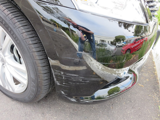 Scraped bumper before repairs and paint at Almost Everything Auto Body