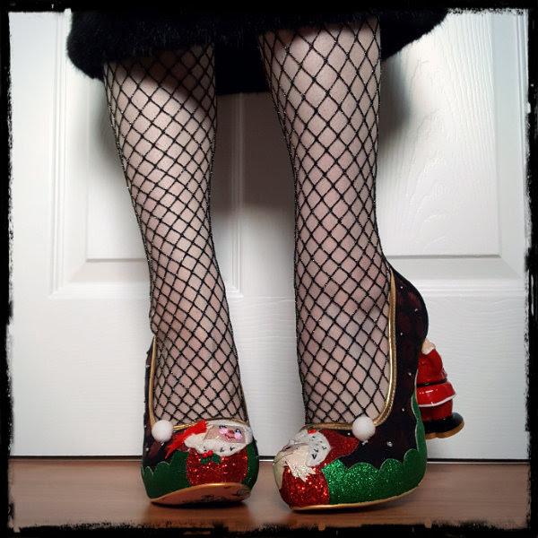 wearing glitter festive shoes with Santa heel