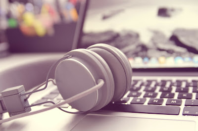 Stock image of a laptop and headphones