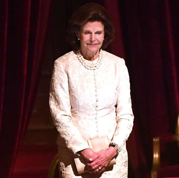 King Carl Gustaf and Queen Silvia watched a performance of the classic opera Rigoletto at the Royal Swedish Opera. pearls necklace