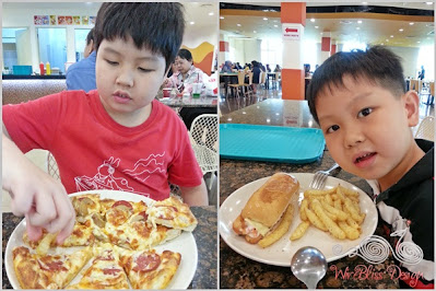 Boys having pizza and chips for lunch