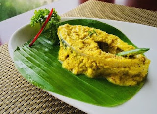 Hilsa wrapped in green leaves