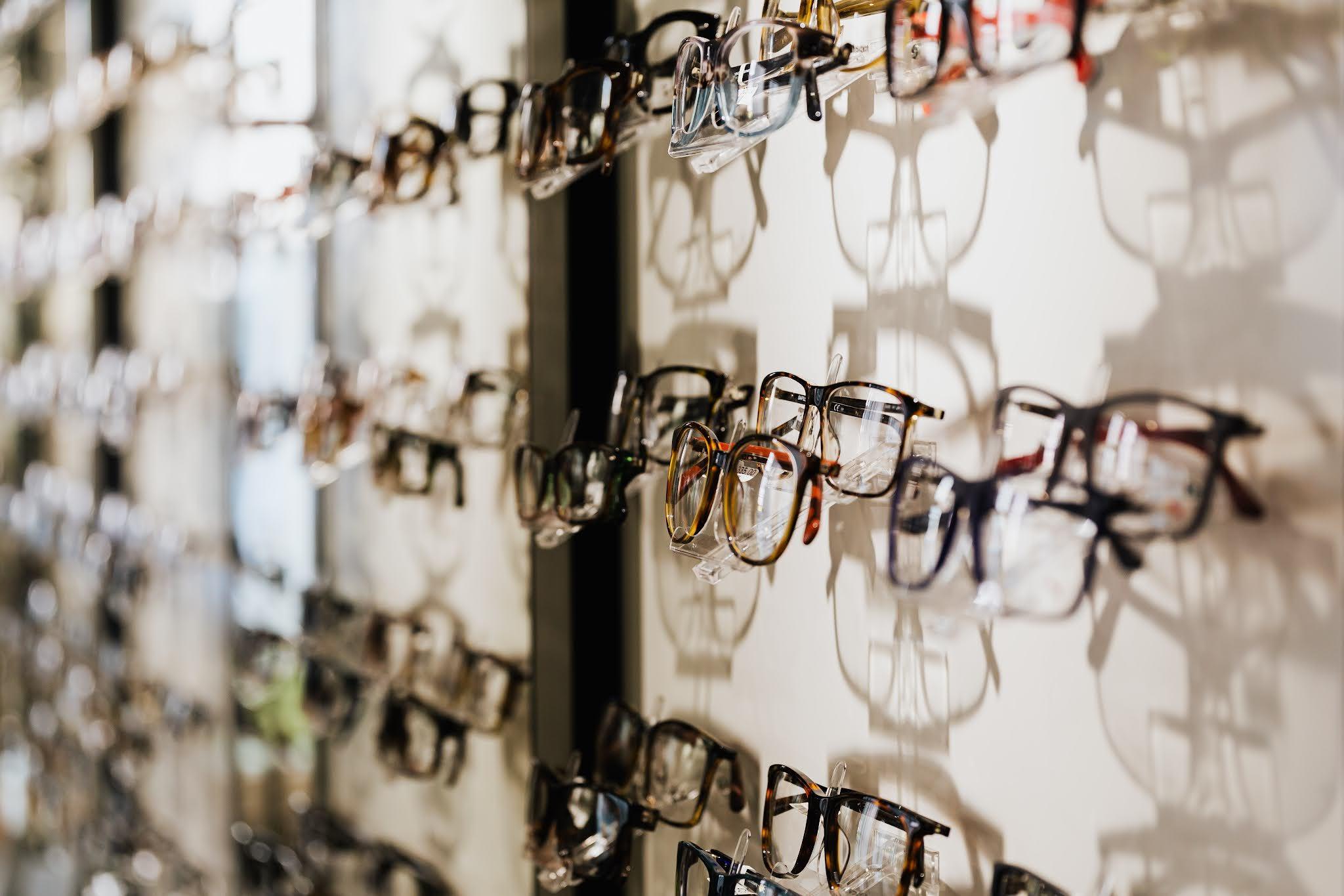a range of glasses in an opticians. Image free stock image from Pexels by Karolina Grabowska