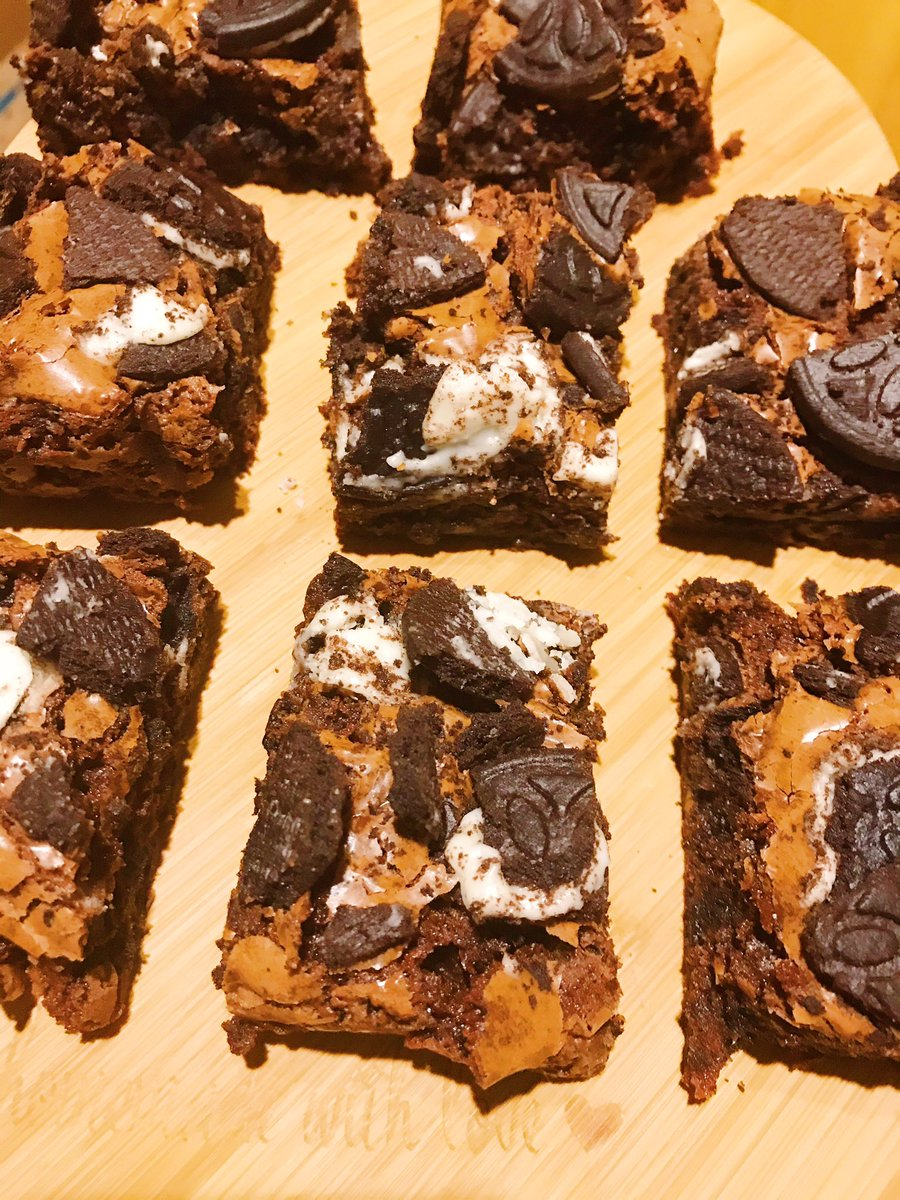 squares of oreo brownies on a heart chopping board