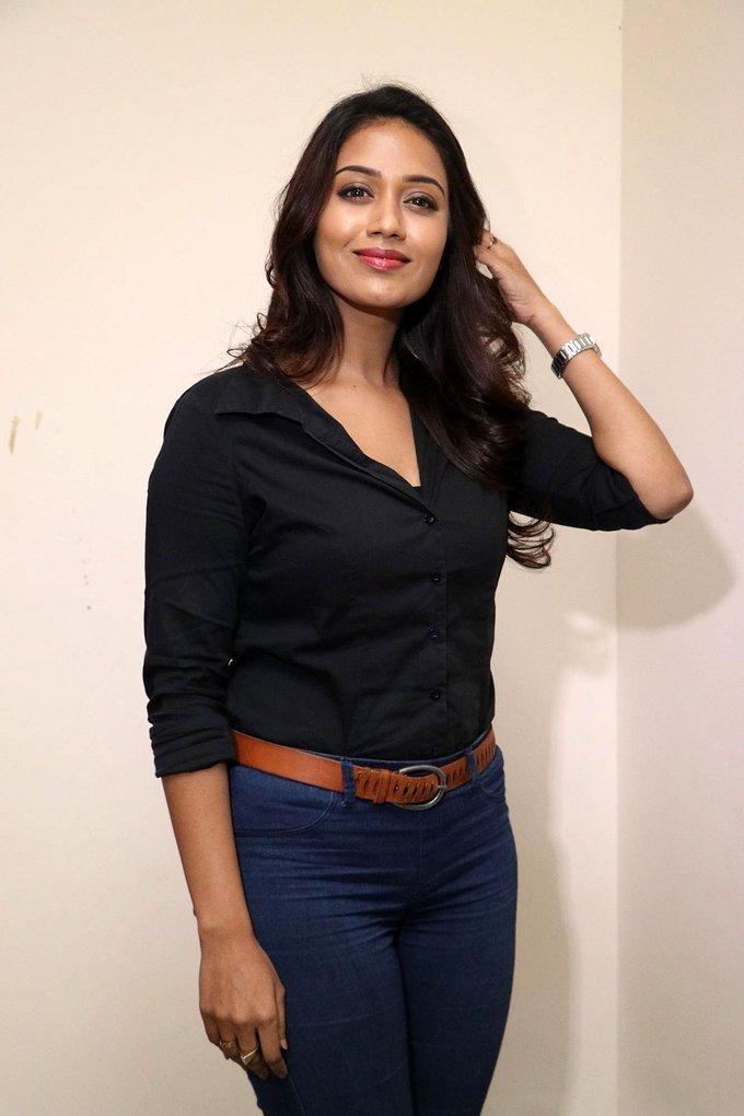 Beautiful Tamil Girl Nivetha Pethuraj Long Hair Stills In Black Shirt Jeans