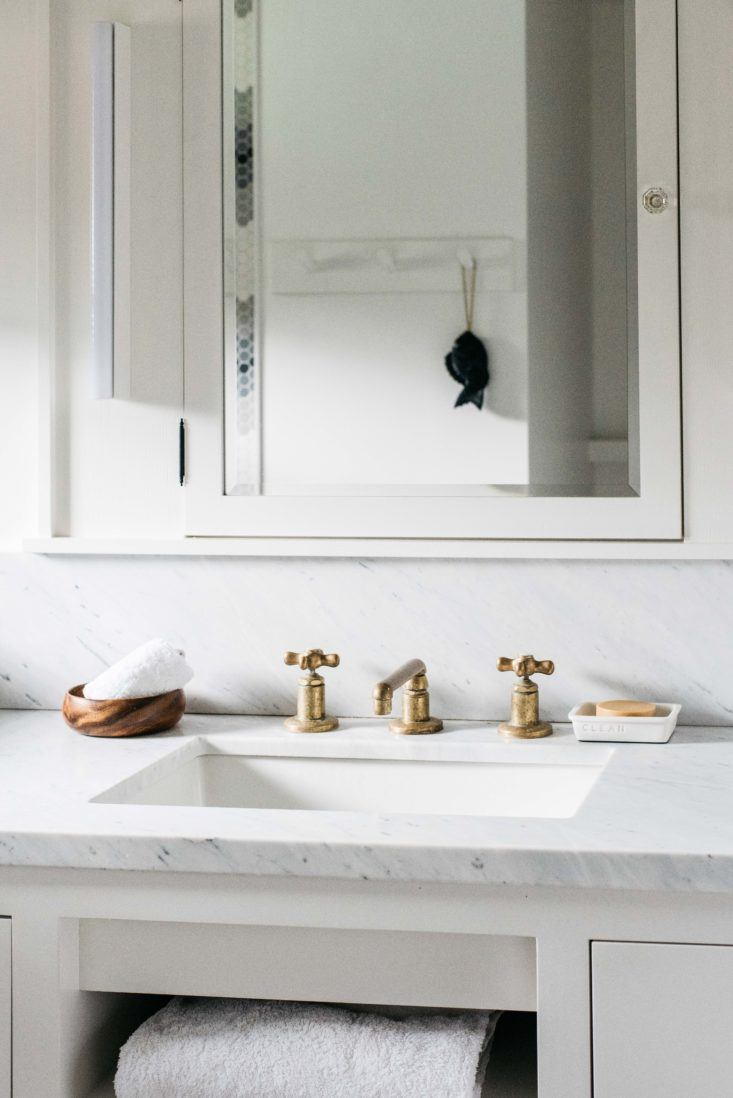 Vanity area with marble in bathroom at beautiful oceanfront cottage on Maui - found on Hello Lovely Studio