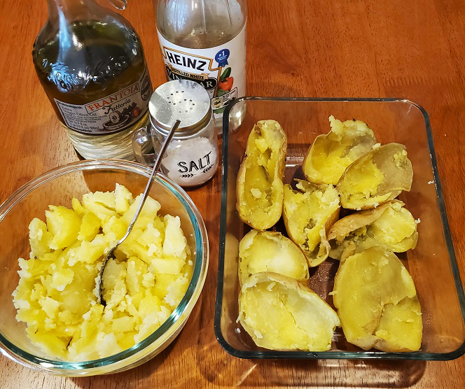 this is a bowl of potatoes with salt and vinegar with the jackets to make twice baked potatoes