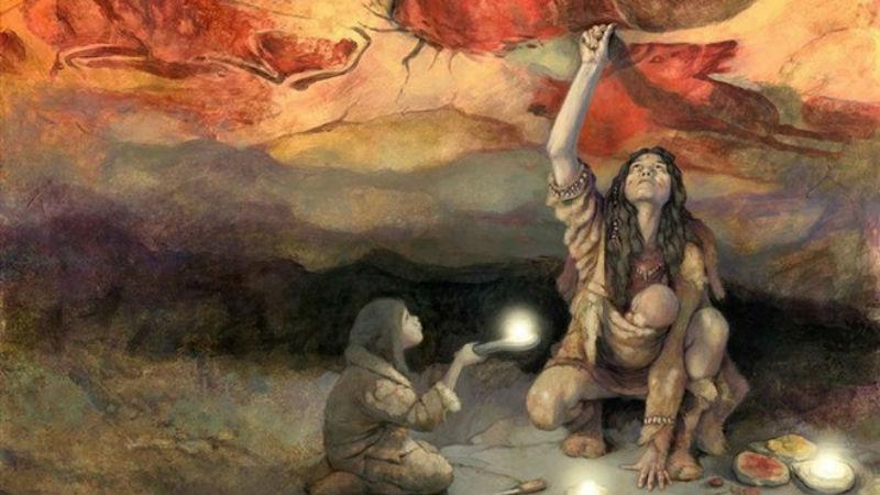 Mujer pintando la Cueva de Altamira en Santander, España