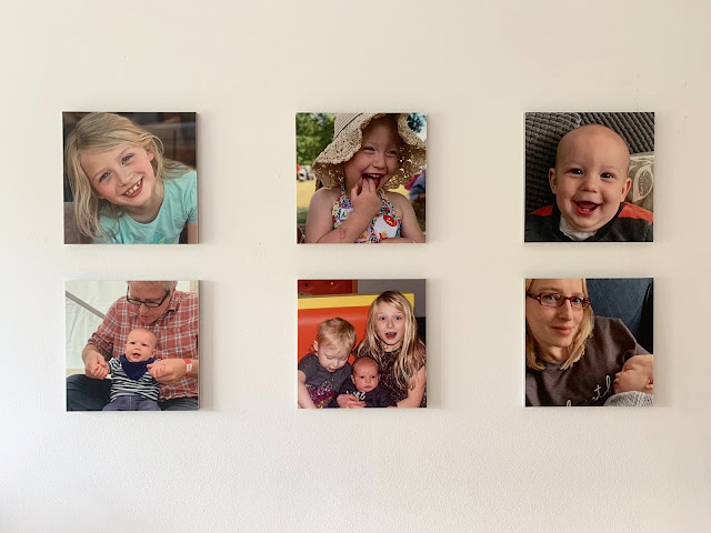 6 photo tiles of a family up on the bedroom wall