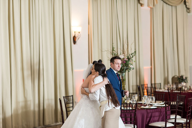 wedding coordinator hugging bride