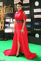Apoorva in a Stunning Tight Leg Split Sleeveless Red Gown at IIFA Utsavam Awards 58.JPG