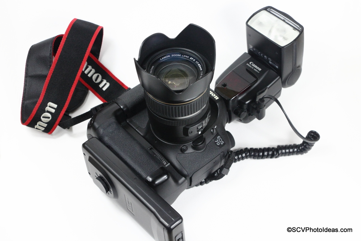 YongNuo SF-18 External Battery mounted on Gripped Canon EOS 7D + speedlite 580EX II