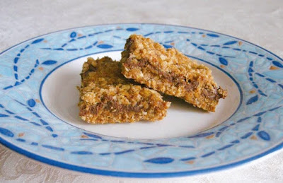 oatmeal and caramel cookie bars on a blue and white plate