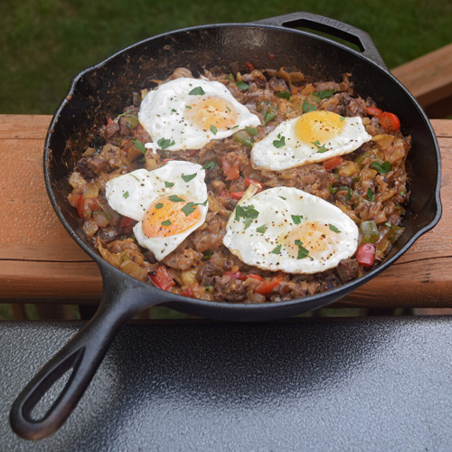 Steak and cheese breakfast hash cooked on the Big Green Egg kamado grill