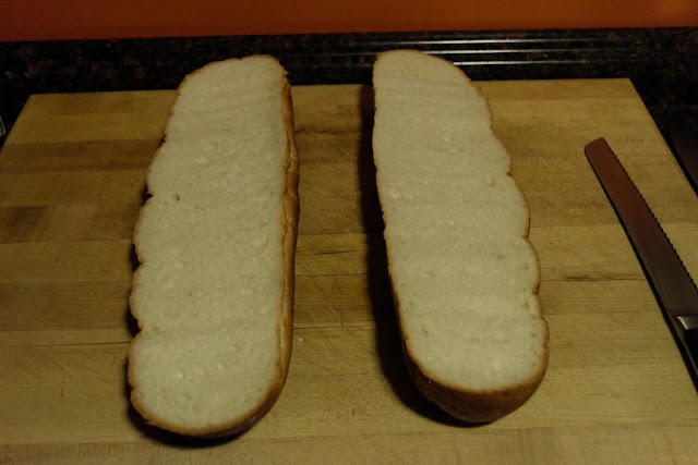 The loaf of French Bread cut in half.
