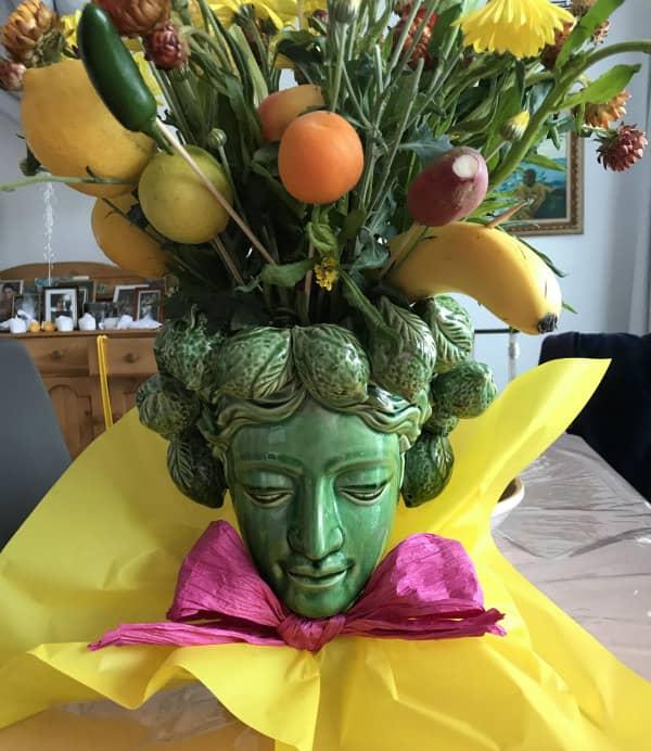 fruit and vegetable arrangement in sculptured head vase