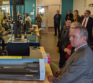 Rep Roy listening as part of the tour of the 'maker space' at Quinsigamond Community College (Nov 2019)