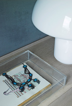 Modern luxury vignette on bedroom nightstand acrylic clear box minimal sophisticated interior design by Piet Boon