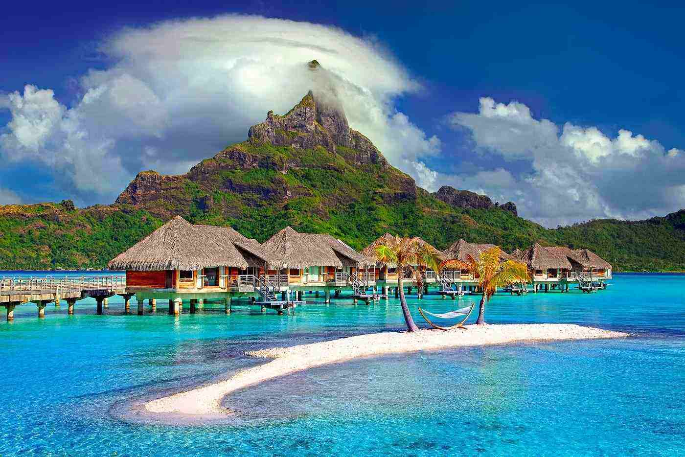 overwater huts with hammock on tahiti - best tropical islands to visit