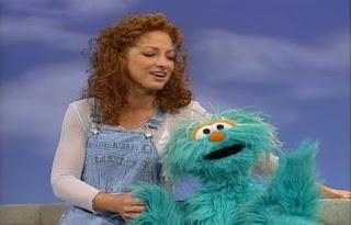 The song Sing, Sing A Song performed by Gloria Estefan and Rosita. Sesame Street Best of Friends