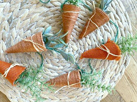 Jute and burlap carrots laying on placemat