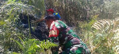 TNI, Polri dan Warga  Lelumu Penuh Perjuangan Memadamkan Api