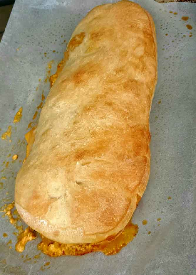 this is a baked pizza roll stuffed with buffalo chicken