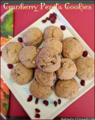 Cranberry Pepita Cookies are Fall in cookie form. Pumpkin flavored cookies are studded with cranraisins and pepitas. | Recipe developed by www.BakingInATornado.com | #recipe #cookies