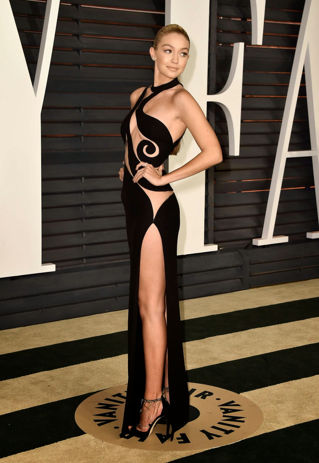 Gigi Hadid flashes skin at the 2015 Vanity Fair Oscars Party in Hollywood