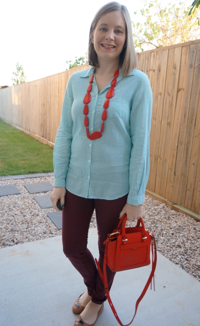 pinstripe shirt with burgundy pants and red accessories matching necklace and bag | away from blue