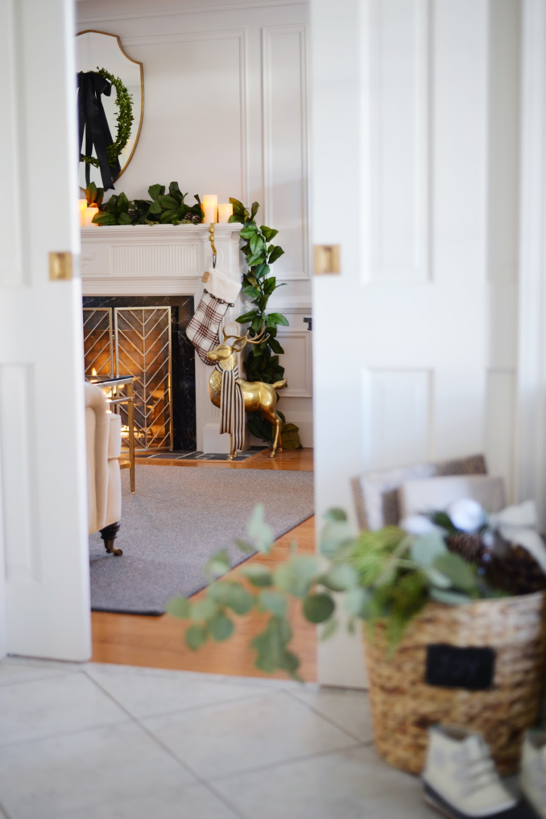 magnolia garland on fireplace mantle, brass elk